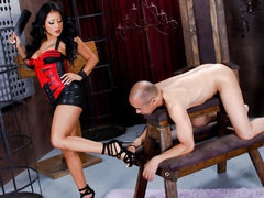 Naked slave guy stands still in front of black haired latin domina Kiara Mia. This babe makes him lick her legs and feet before she bares her huge mambos and big juicy ass. This babe spreads her big buttocks right in front of her slave man.