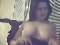 Mom kinkily presses boobs