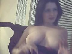 Mom kinkily presses boobs