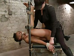 With her feet tied up and metal clamps all over her body the ebony doxy endures a harsh punishment. This mistress knows what he's doing and gives her both pain and pleasure. She can't even scream as her mouth is folded with scotch tape. Look at that shaved pussy and how deep she's rubbing it with the vibrator.