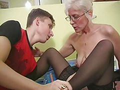 Mature with Silver Hair Glasses and Stockings Wakes the Chap