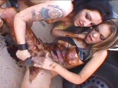 Tattooed girls get messy having lesbian sex