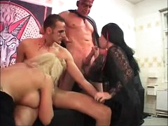 Strange foursome with tattooed and pierced girls