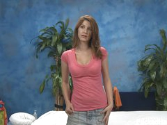 Tender brown haired girl Karina in pink t-shirt and blue jean mini skirt does some modelling in the massage room with her garments on before massage. Do you like her cute face and sexy legs?