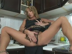 Long legged milf Tara Romain takes Steve's cock in her mouth immediately after masturbating with dildo on the kitchen counter. She sucks his schlong like crazy and then offers her dripping wet pussy to hot guy.