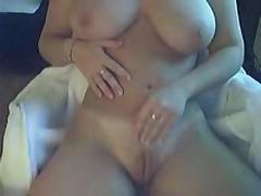 Bosomy doll masturbating