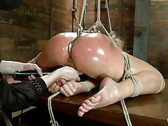 tied lea lexis with a hook in her anus getting fingered