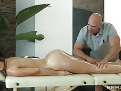 Look at this gorgeous dark brown having a massage on her long hot legs and her hawt body. Just at the view of her moistured ass and her tight pussy that babe gets the guy all horny and makes him wanna give it to her deep. Do you think that babe needs some semen with all that oil or a big hard cock in her cunt?