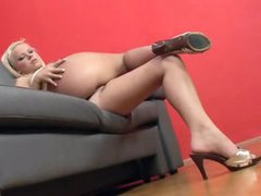 Shaved pussy fingered by the hot blond in heels