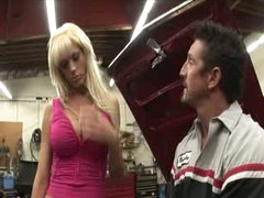 Busty blonde penetrated over the car