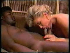 Two black lads fuck white slut in classic video