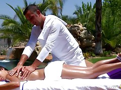 hot brunette getting oiled at massage