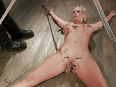 Slutty blonde Marie has her body all tied up and her legs spread on the floor. Her horny executor enjoys touching her wet shaved pussy and torturing it at the same time with a lot of laundry pliers. That guy tickles it, but doesn`t let her cum too soon. That guy first wants to bring a vibrator in the scene. So hot!