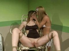 Youthful nurse punishing slavegirl