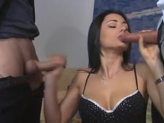 Euro angel in boots feasts on two dicks