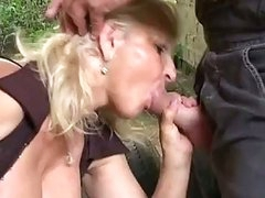 Blonde granny group-fucked hard outdoors by massive young cock in ass
