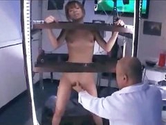 Asian Girl Standing In A Cage Stimulated And Fucked With Toys Getting Her Bushy Pussy Licked By Man In The Lab