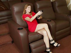 blonde bitch masturbates on an armchair