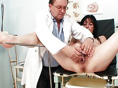 Mature brunette sweethearts with nice body and naughty breasts is sitting the gynecologist table completely undressed with her legs spread so that her doctor can exam the cum-hole between them. He recommends her a dildo therapy so the treatment begins as he introduces that sex toy deep in her shaved vagina. She becomes horny and does treats her pussy with her own hands.