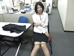 bored asian gal sucks a dildo at work
