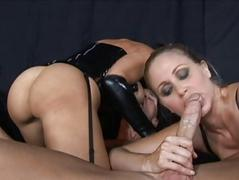 Brunette and blonde milfs engulfing cock and fucking hard