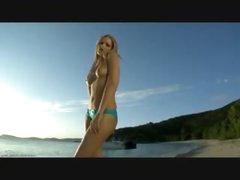 Perfect bikini girl on a beach gets sexy