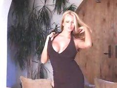 Busty pornstar in black dress striptease