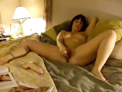Amateur in glasses masturbates in couch
