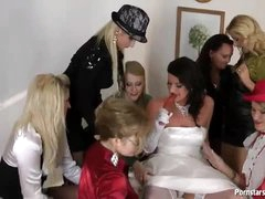 A bride and her sexy clothed friends get naughty