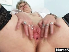 Busty granny in uniform stretching her aged fur pie