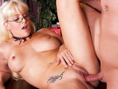 Blonde haired four-eyed milfy librarian Heidi Mayne has a wonderful time egtting her shaved neat pussy drilled by horny hard dicked dude after she blows his dick. She has sexy tattoos all over her hot body.