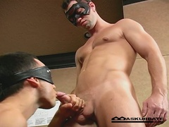 Masked guys engulf cock and team fuck ass