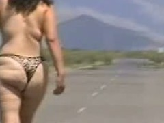Out in the open desert walking in the centre of a highway with only a g-string covering her big ass body. In this public sex video you can see this mature bitch walk undressed out in the open and flaunt her big fucking ass.