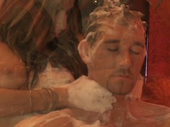Pair have a fun erotic bath time soapy massage
