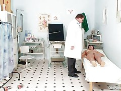 she spreads her legs for her pussy to be examined