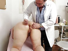 overweight blonde getting her mature vagina examined