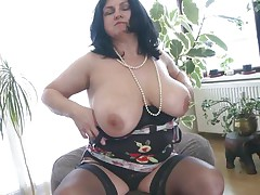 busty older lady showing off and masturbating