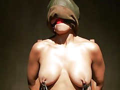 Sexy Beretta sits on a chair with her hands tied up and is mouth gagged. With her nipples tortured, her executor moves to her tiny vagina and puts a pump on it to suck it all in. The bitch moans with pleasure, while he sticks a marital-device on her wet cunt and grabs her nipples a little. This is so hot!