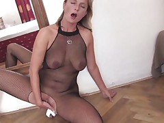 mature blonde masturbating on the floor with a sex tool