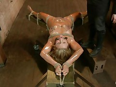Blonde slut Cameron is all tied up with strings to a wooden table and mouth gagged. With her legs spread, she gets fingered and has a marital-device on her clitoris. Let`s take a close look at that hot oiled up body and with wax all over her! Will her mistress make that doxy cum if her cunt gets fisted so hard?