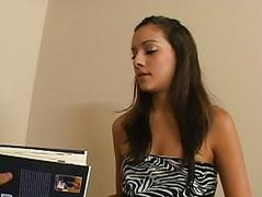 Gorgeous brunette teen with natural tits reading a book and masturbating