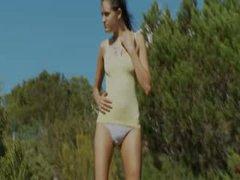 Extra slim girl make striptease outsite