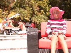 Guys oil up doxy in a shiny bikini